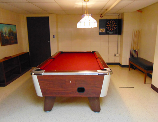 A pool table is available for residents to use in the Activity Room.