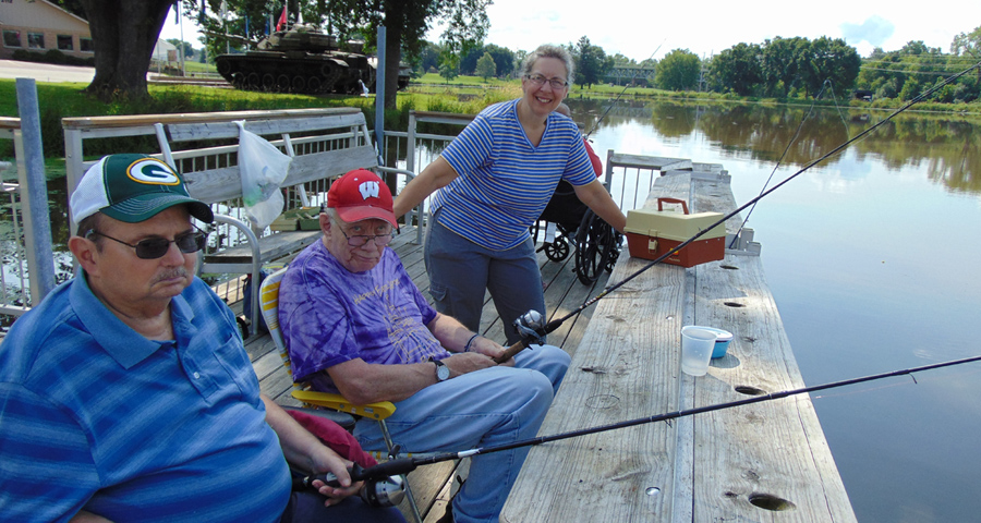Rolling Hills volunteer and residents fishing